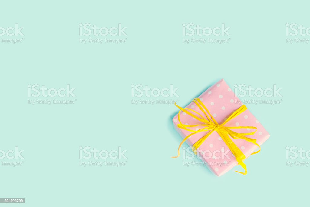 Gift box wrapped in pink dotted paper. Vintage effect. stock photo