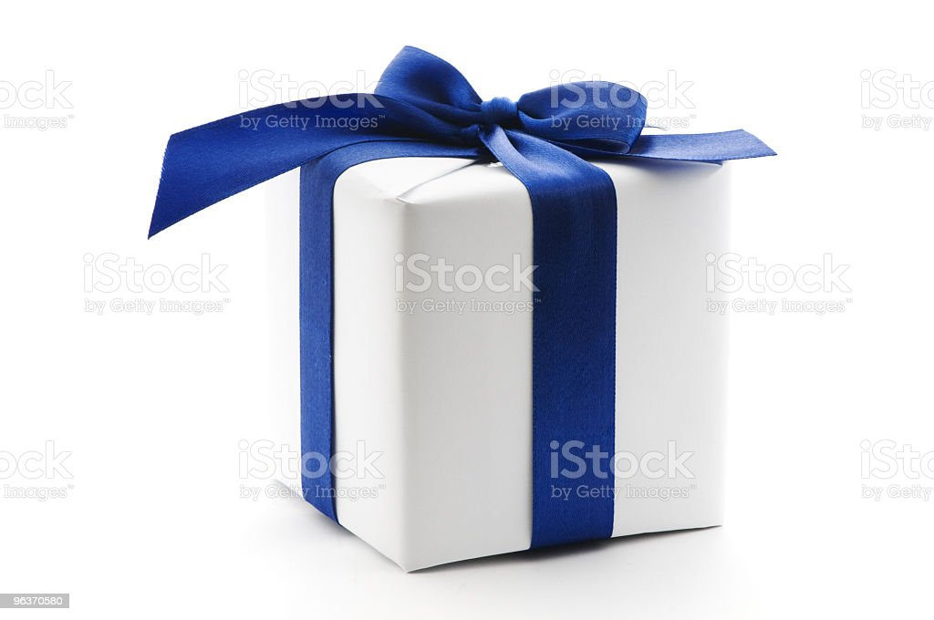A gift box wrapped in white with blue ribbon royalty-free stock photo
