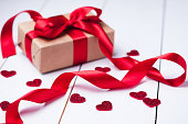 Gift box wrapped with a red ribbon.Valentine's day background.
