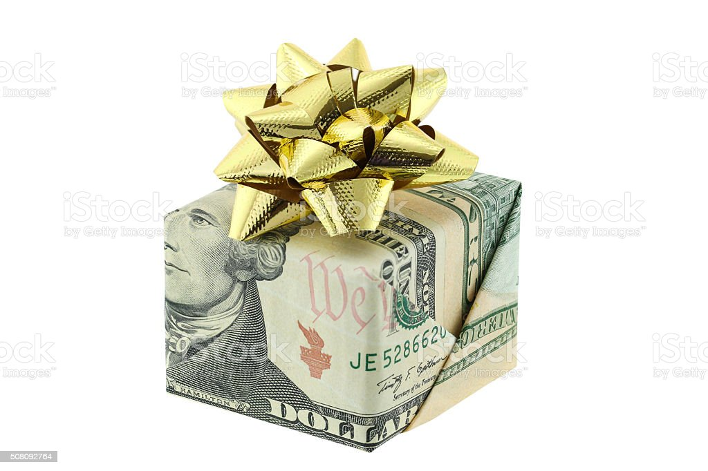 Gift box wrapped with US Dollar decorated with golden ribbon stock photo