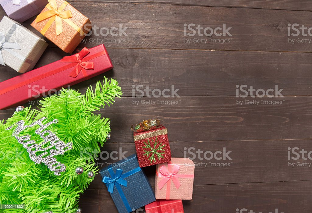 Gift boxes and Christmas tree on the wooden background stock photo