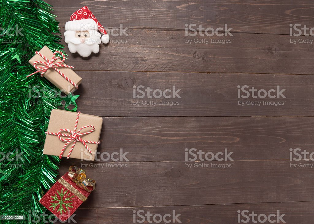Gift boxes and santa claus are on the wooden background stock photo