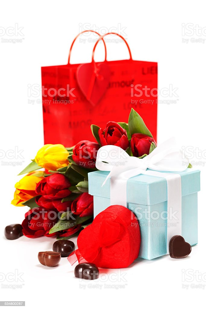 gift boxes, chocolate and fresh flowers stock photo