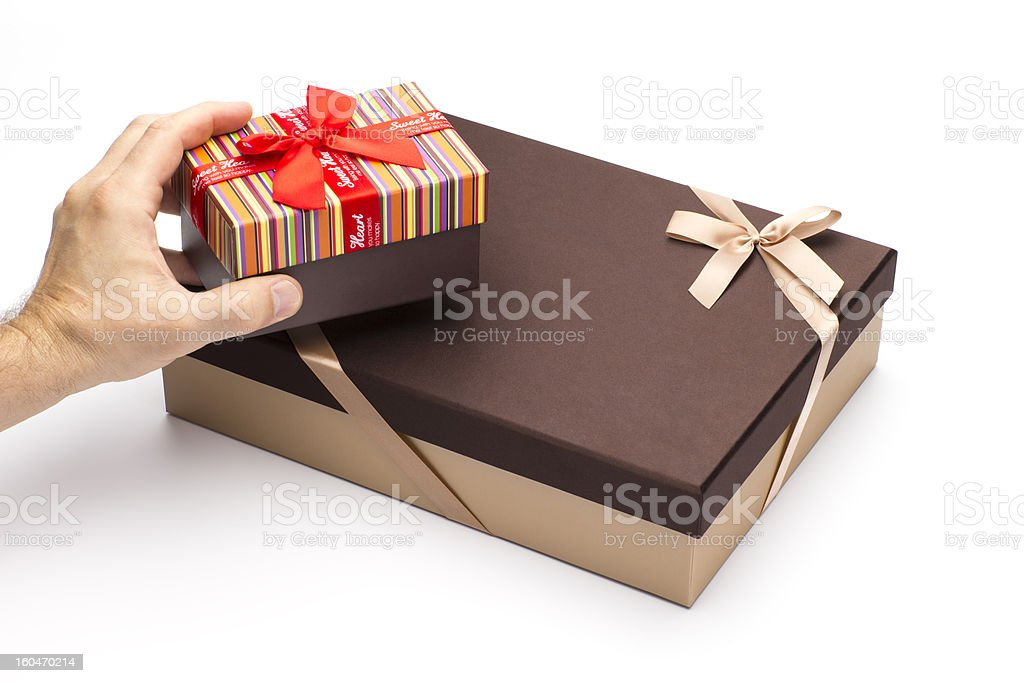 Gift boxes in hands on a white background. royalty-free stock photo