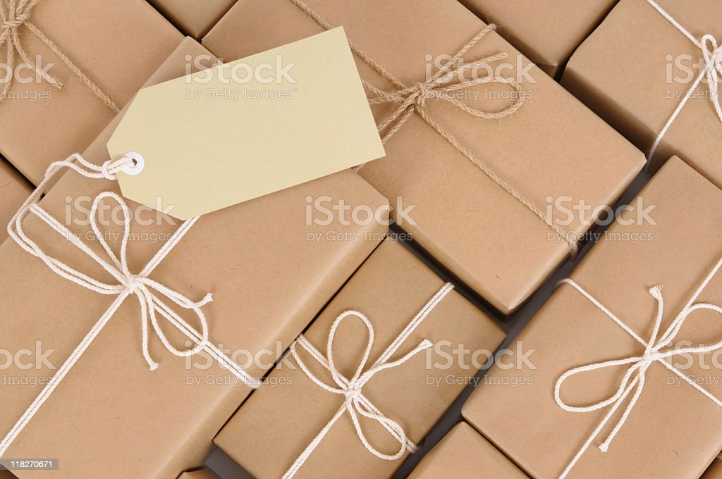 Gift boxes made of brown paper with a tag stock photo