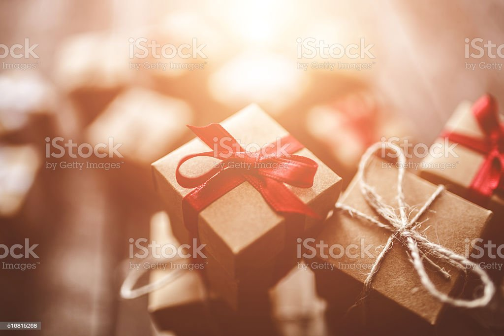 Gift boxes on wood with light effect stock photo