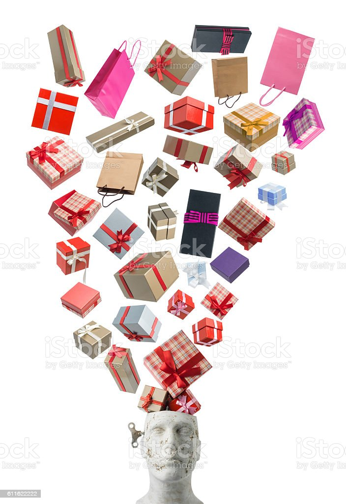 Gift Boxes With Ribbons Falling Into Plastic Mannequin Head stock photo