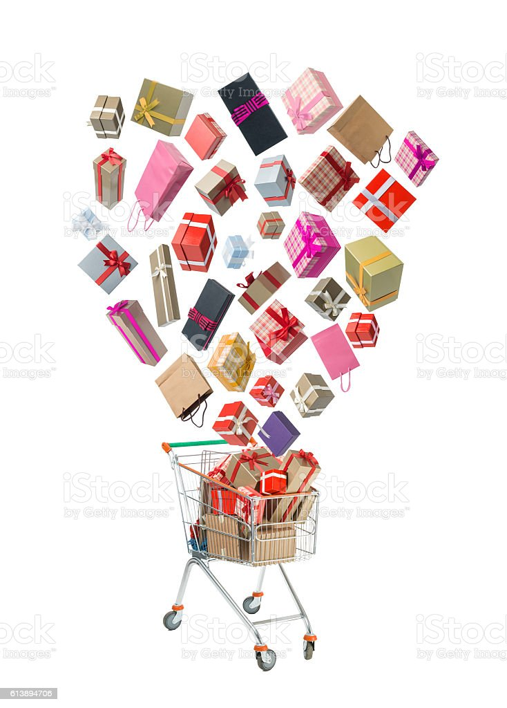 Gift Boxes With Ribbons Falling Into Shopping Cart stock photo