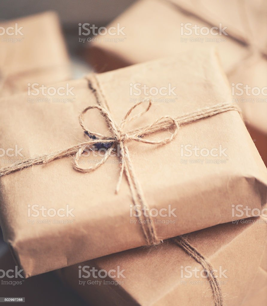 gift boxes wrapped in brown paper stock photo