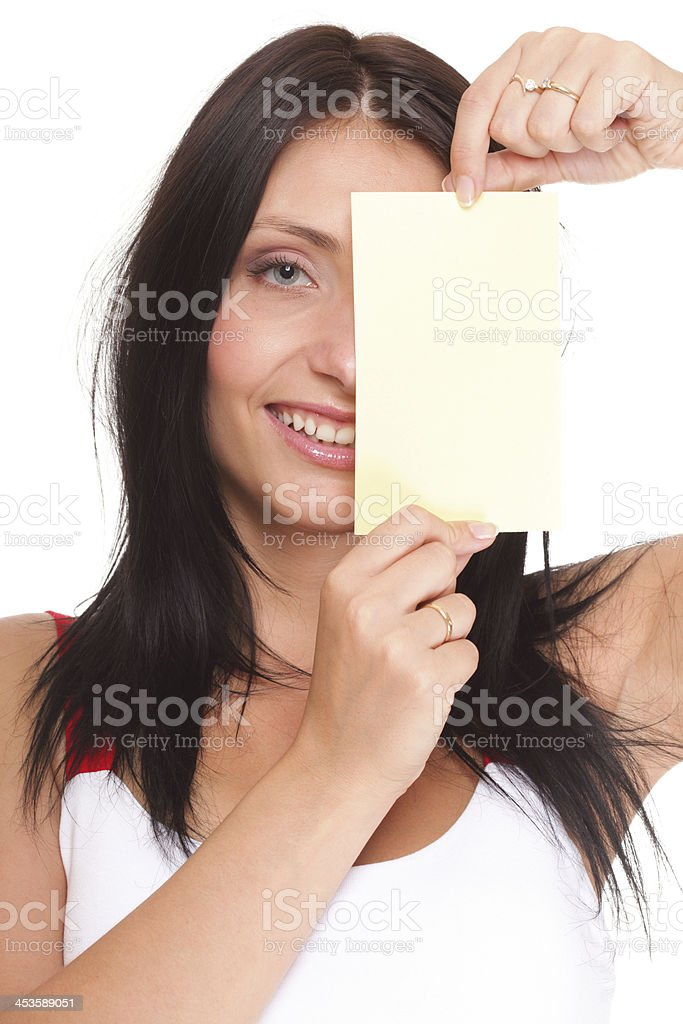 Gift card. Excited woman showing empty blank paper card sign royalty-free stock photo