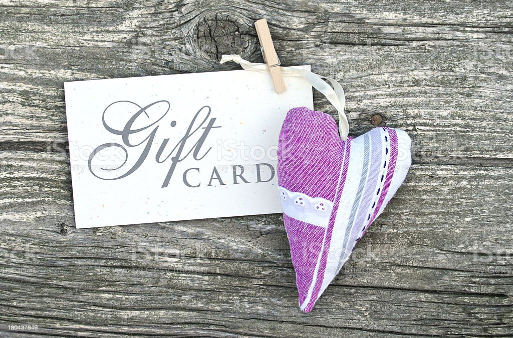 Gift card in white with a cloth heart stock photo