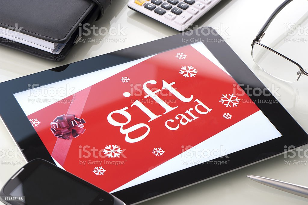 Gift card on a digital tablet stock photo