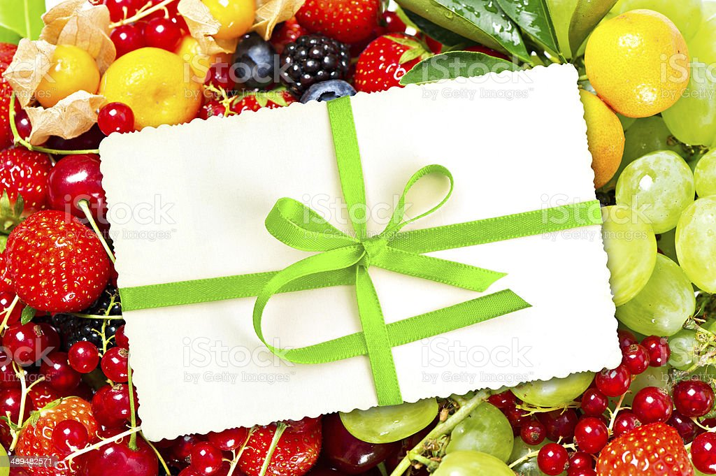 gift card with fresh fruits and berries stock photo