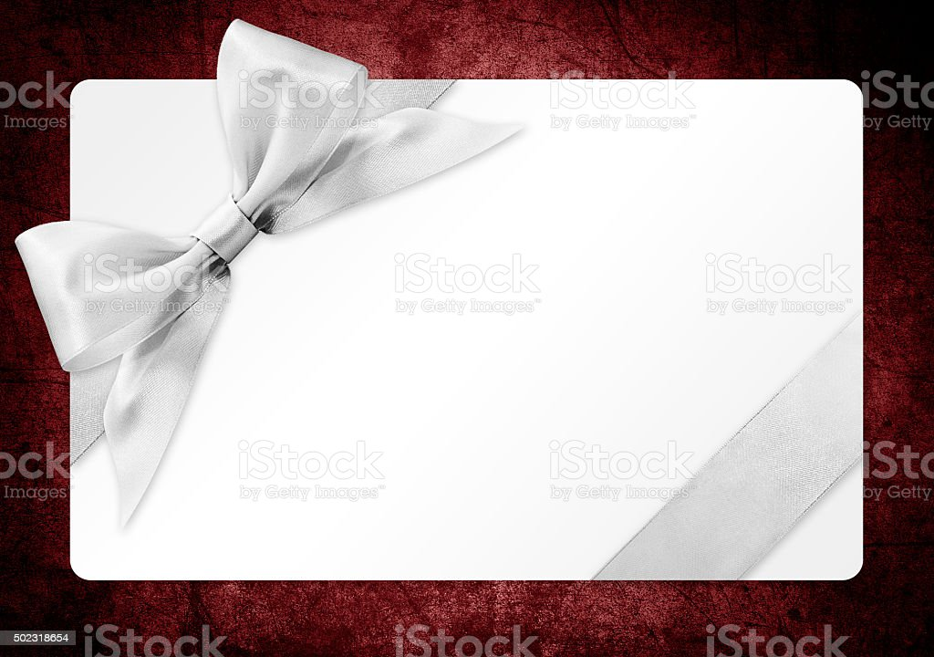 gift card with silver ribbon bow Isolated on red backgrou stock photo