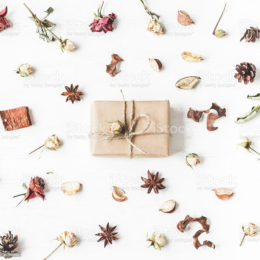 Gift, dried flowers and autumn leaves. Top view, flat lay stock photo