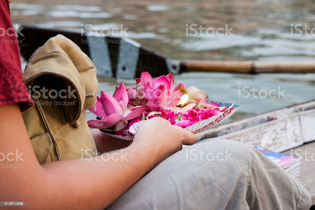 Gift for the dead people in Ganga River. Varanasi. India. stock photo