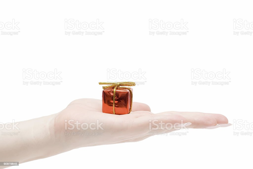 Gift in a hand royalty-free stock photo