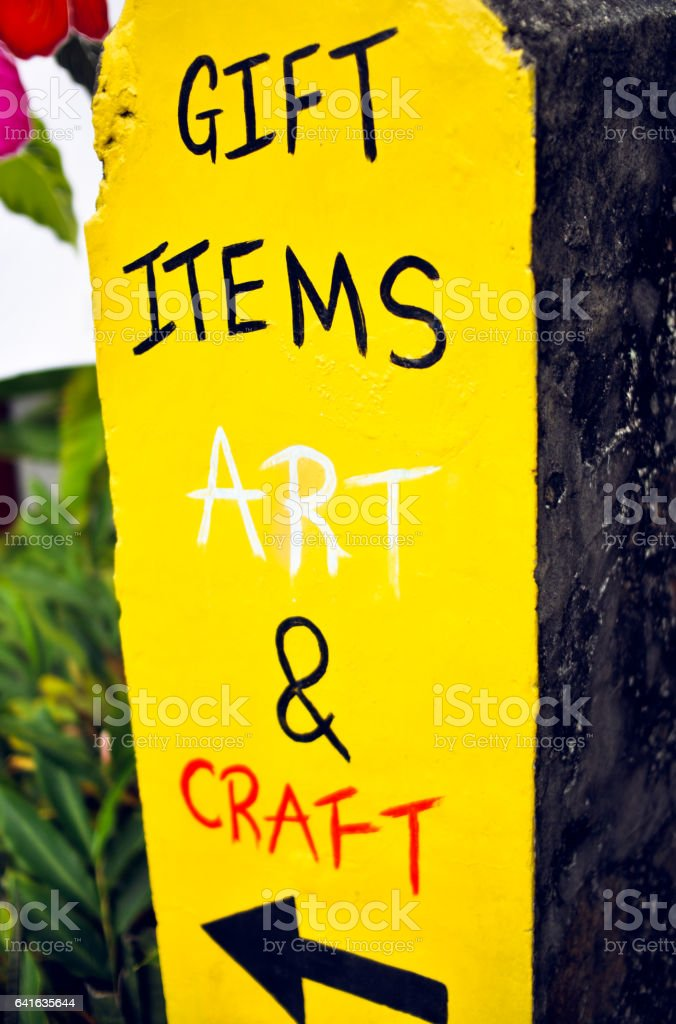 Gift items, art and craft bright  conspicuous yellow handmade signboard stock photo