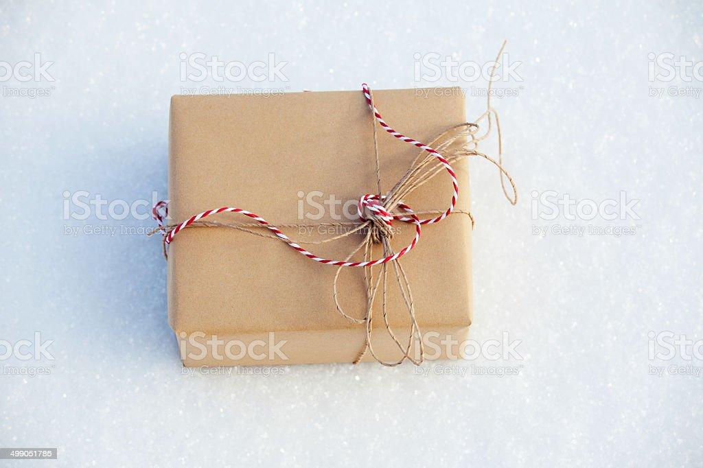 Gift on snow stock photo