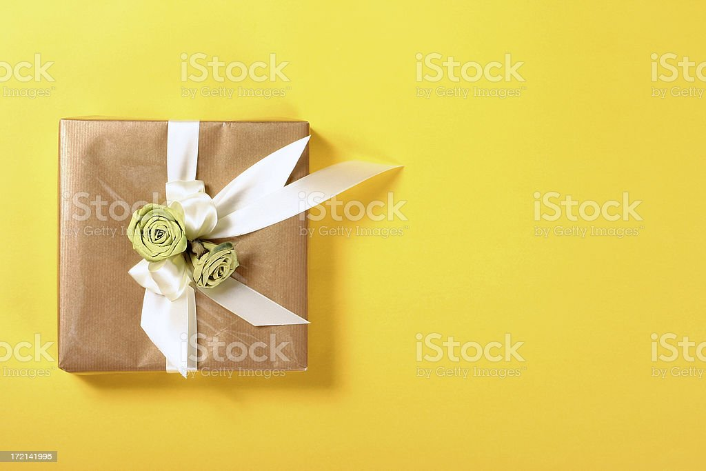 Gift on yellow background royalty-free stock photo