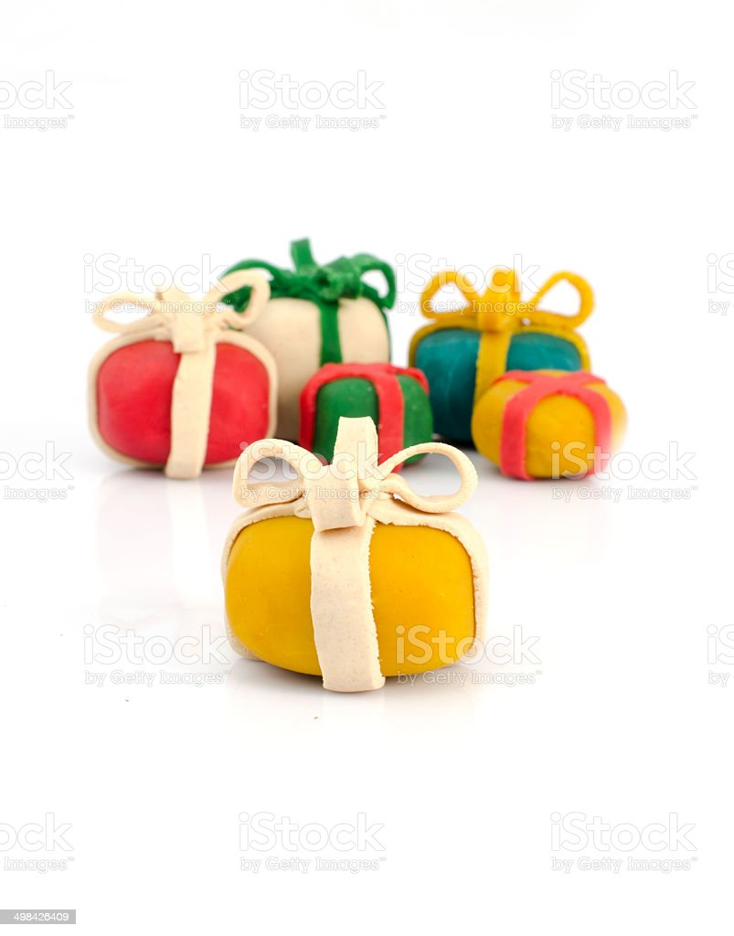 gift packages for children from play dough and white background royalty-free stock photo
