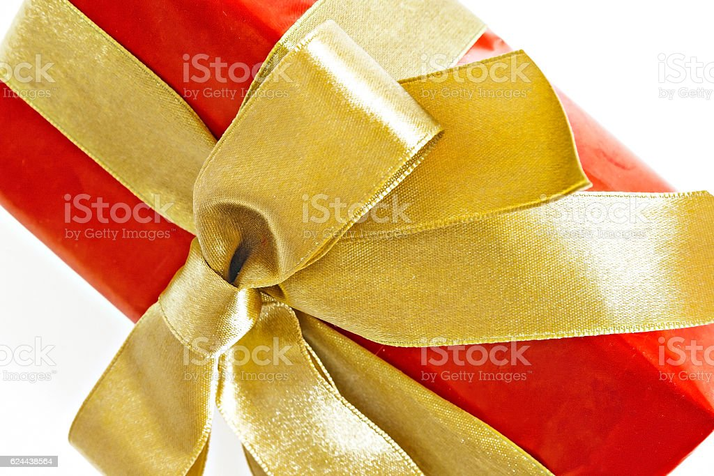 Gift red box with gold ribbon and bow isolated.