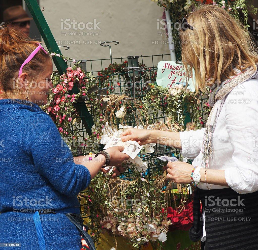 Gift seller taking money from customer stock photo