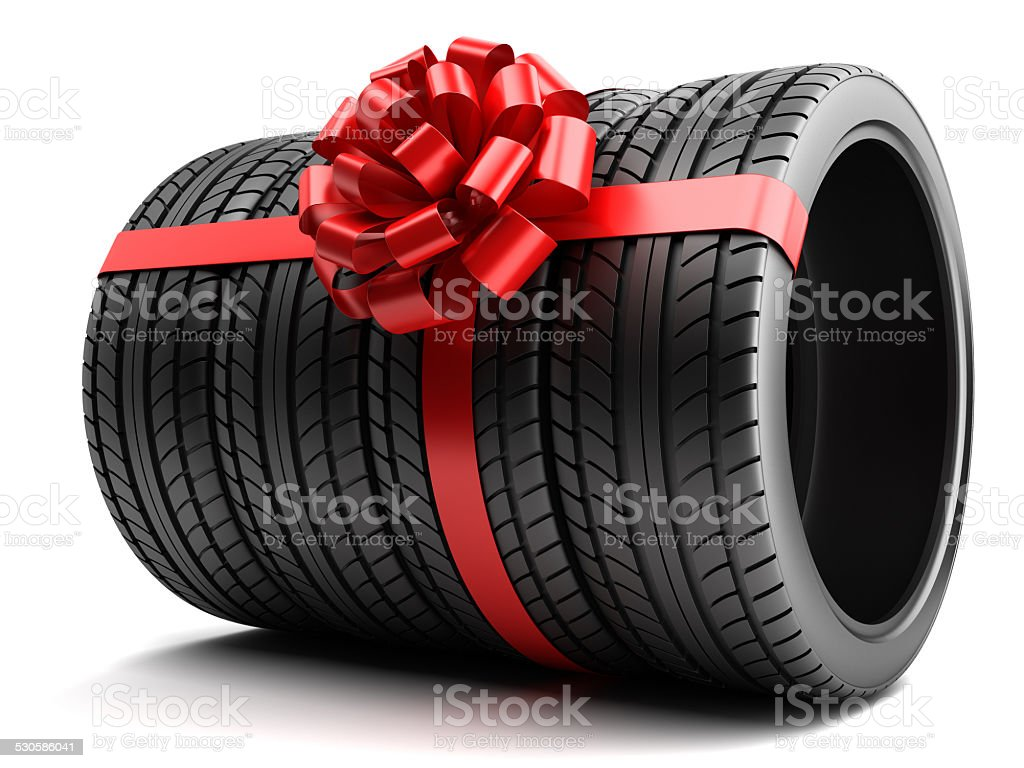 Gift set of tires wrapped ribbon and bow isolated stock photo