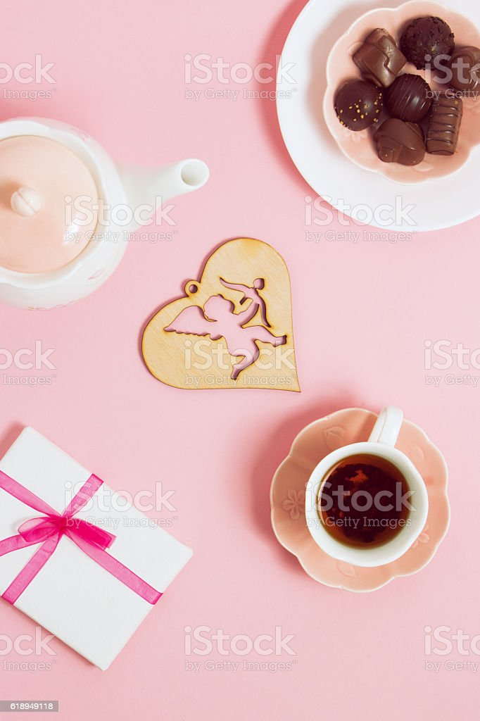 Gift to Valentine's Day, with tea and cupids on stock photo