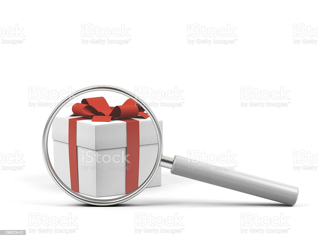 Gift under magnifying glass on white background. royalty-free stock photo