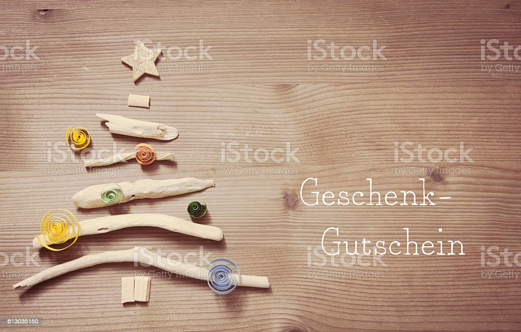 Geschenk-Gutschein - voucher in german stock photo