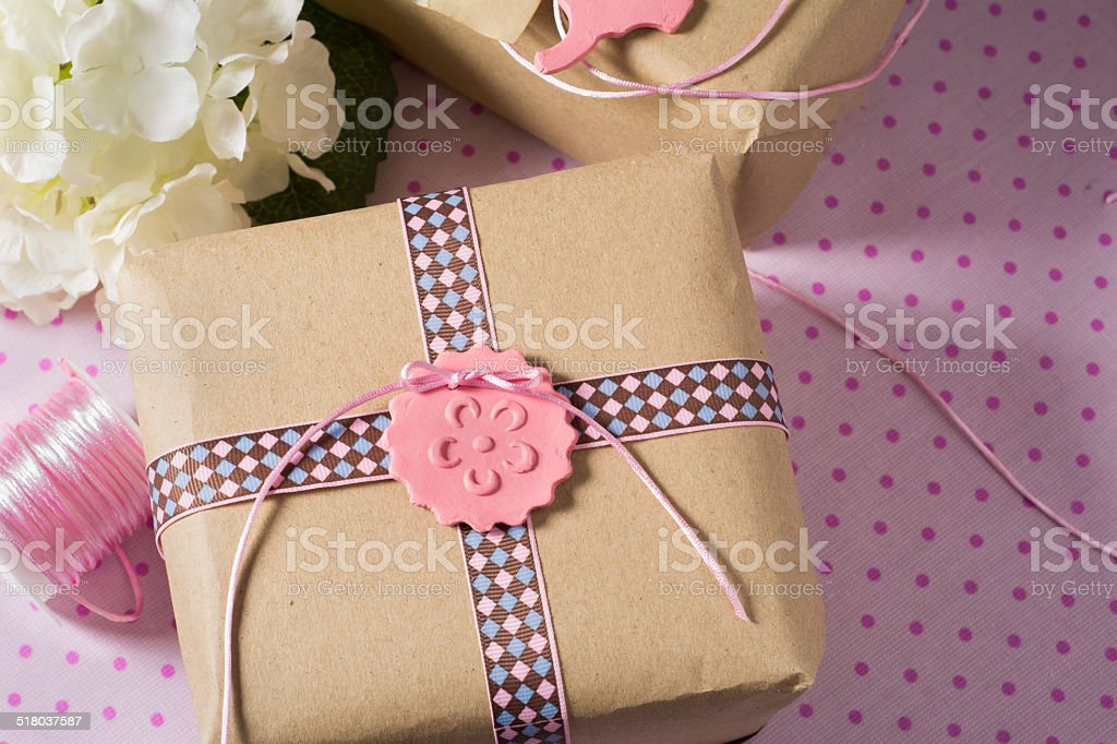 Gift wrapped in recyclable paper, ribbons and flower stock photo