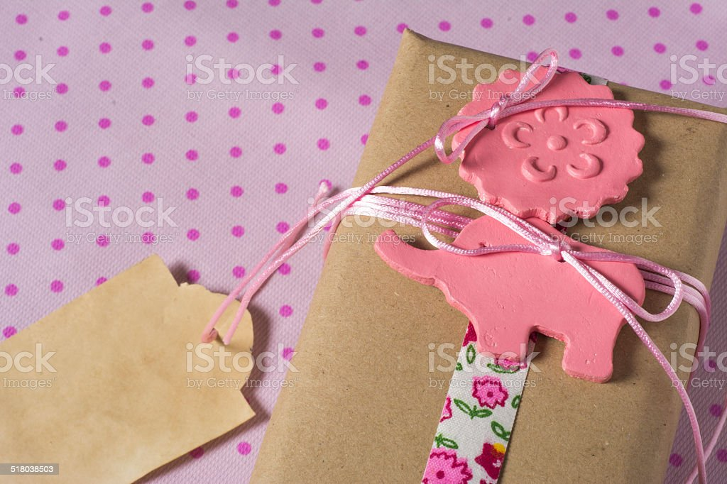 Gift wrapped in recyclable paper, ribbons and label flower stock photo