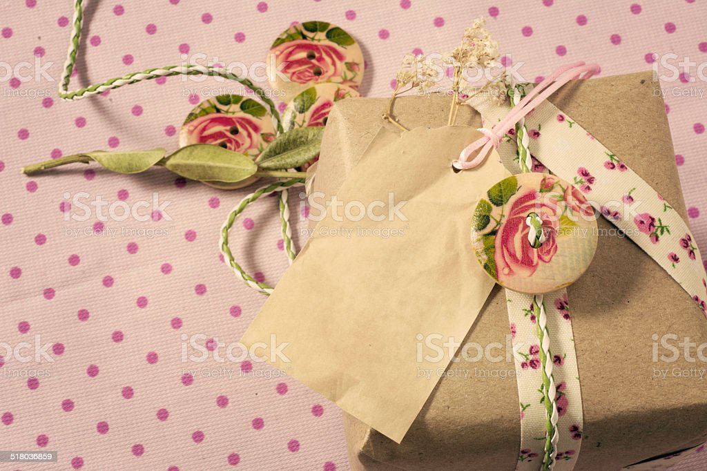 Gift wrapped in recyclable paper, ribbons, decorated with wooden stock photo