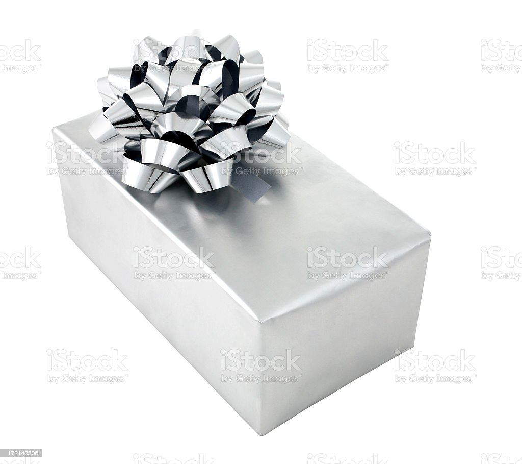 Gift wrapped in silver paper with silver foil bow royalty-free stock photo