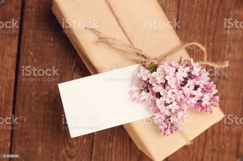 Gift wrapped with kraft paper stock photo