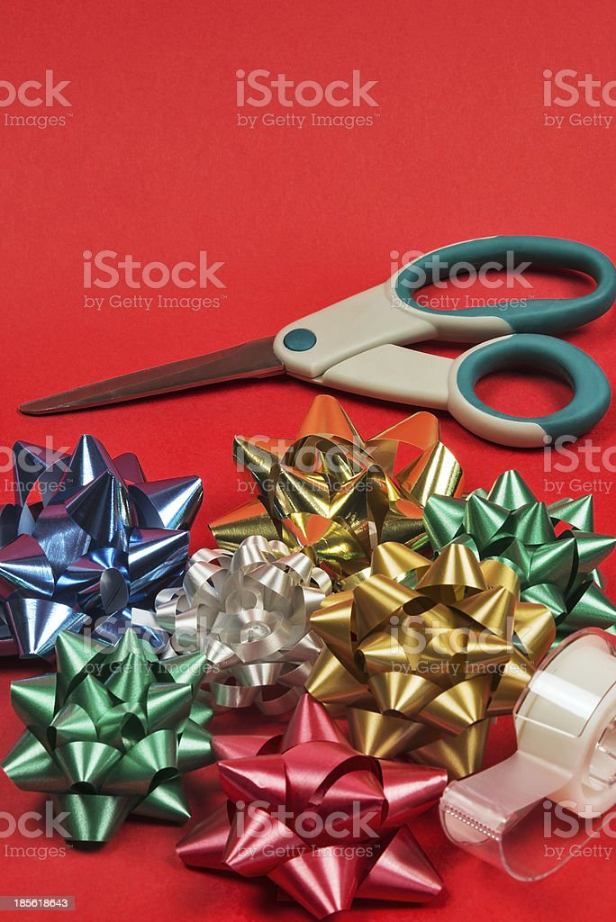 Gift wrapping supplies isolated on a red background royalty-free stock photo