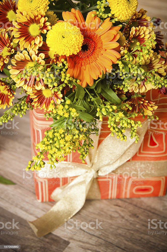 giftbox and a bouquet of flowers royalty-free stock photo