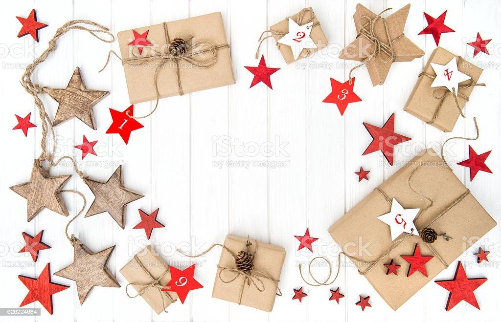 Gifts Advent calendar Christmas decoration stars Flat lay stock photo