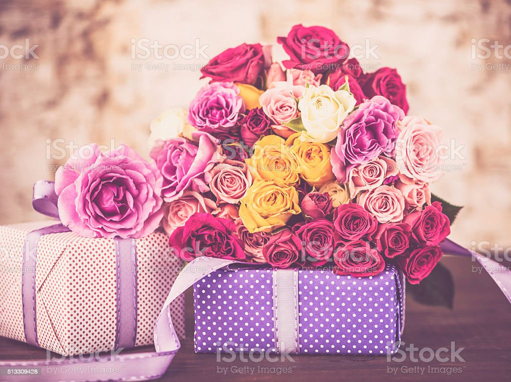 Gifts and roses for mom on Mother's Day or birthday stock photo