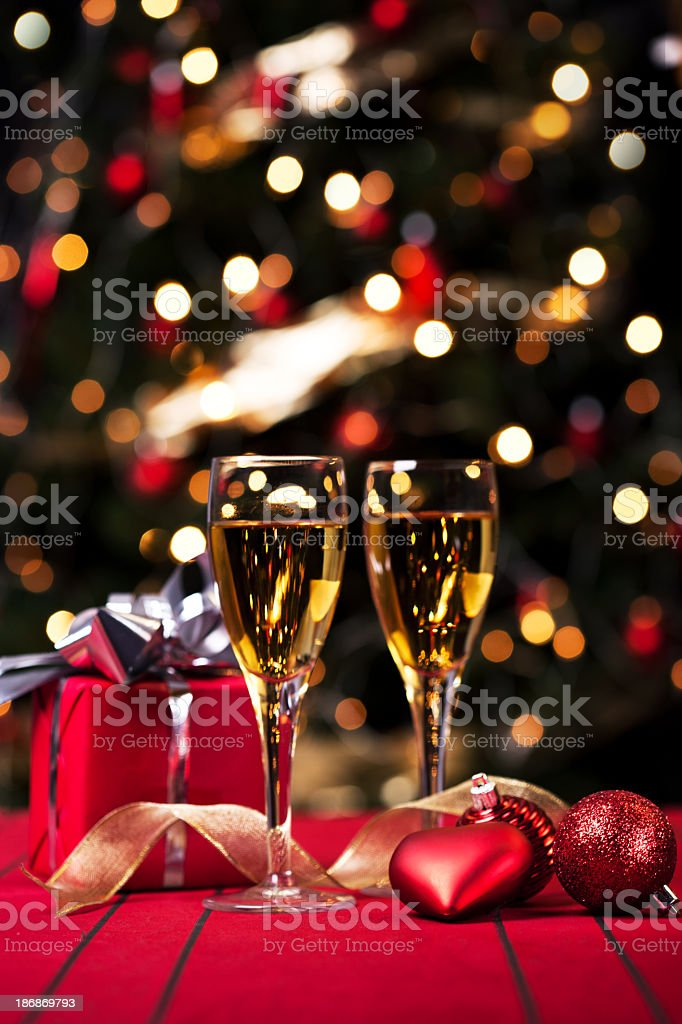 Gifts bauble lights and wine stock photo