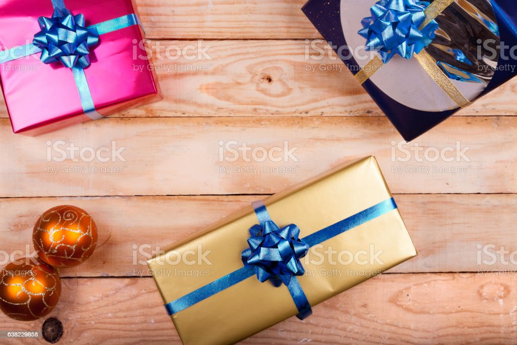Gifts on wood stock photo
