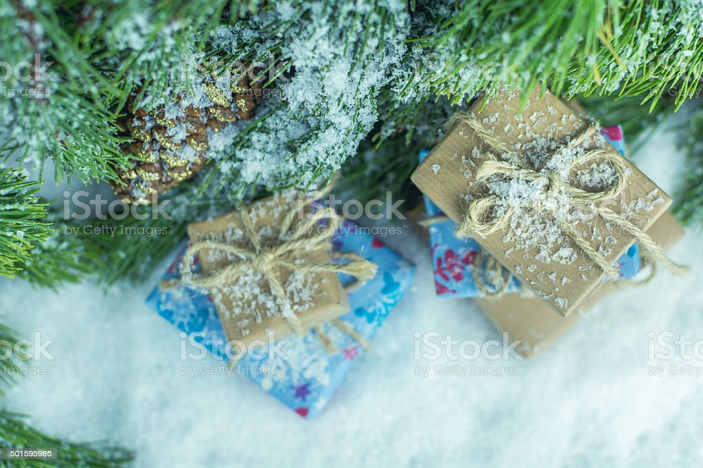 Gifts Under Christmas Tree, Snow, Holiday Background stock photo