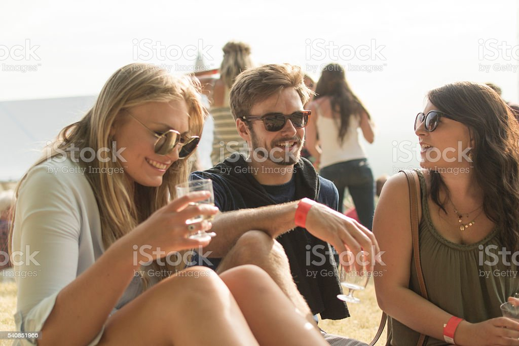 Giggling at the festival stock photo