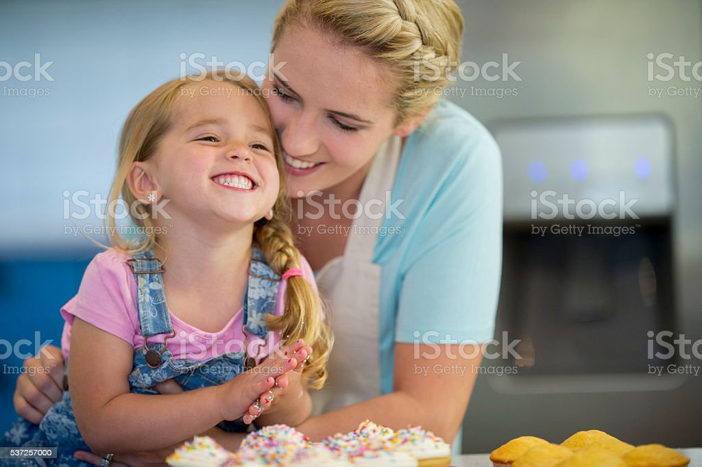 Giggling in the Kitchen stock photo