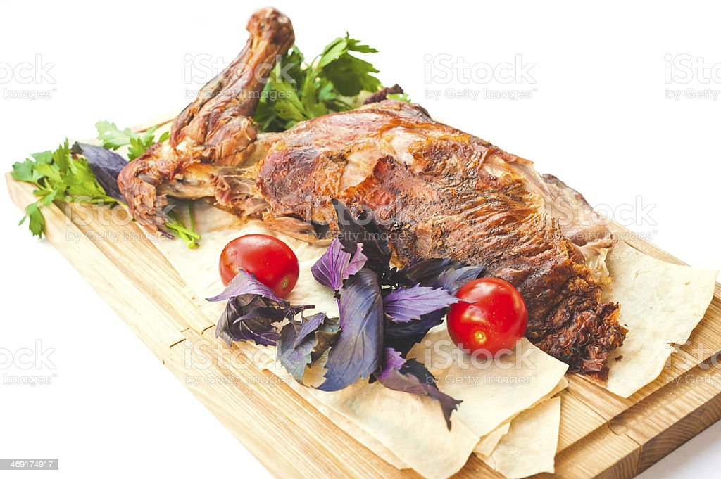 Gigot with fresh tomatoes and basil royalty-free stock photo