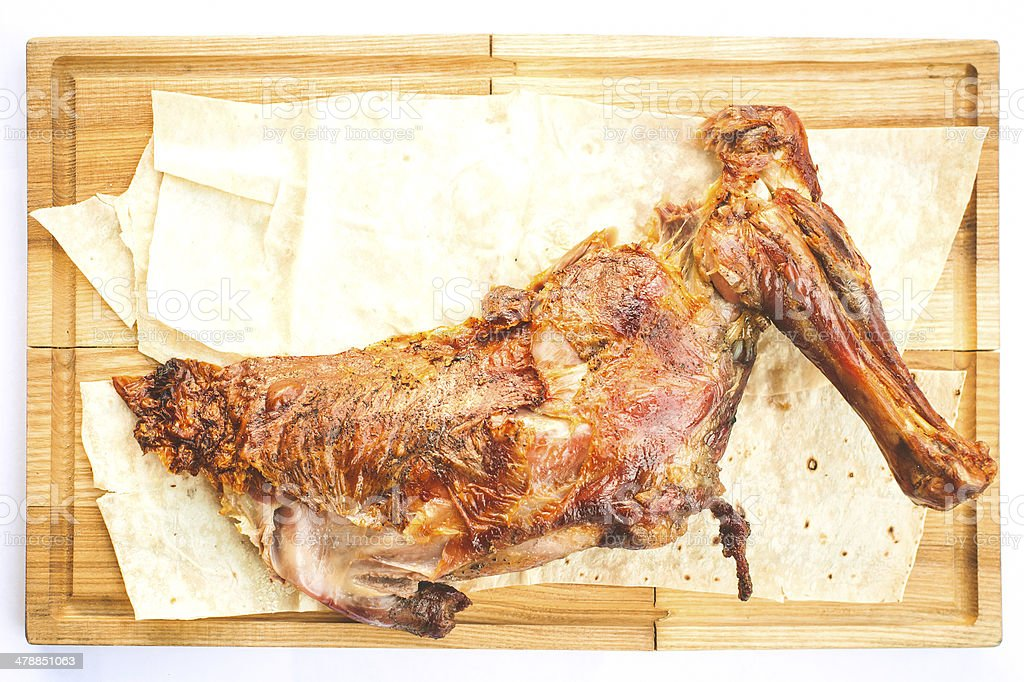 Gigot with pita on wooden plate royalty-free stock photo