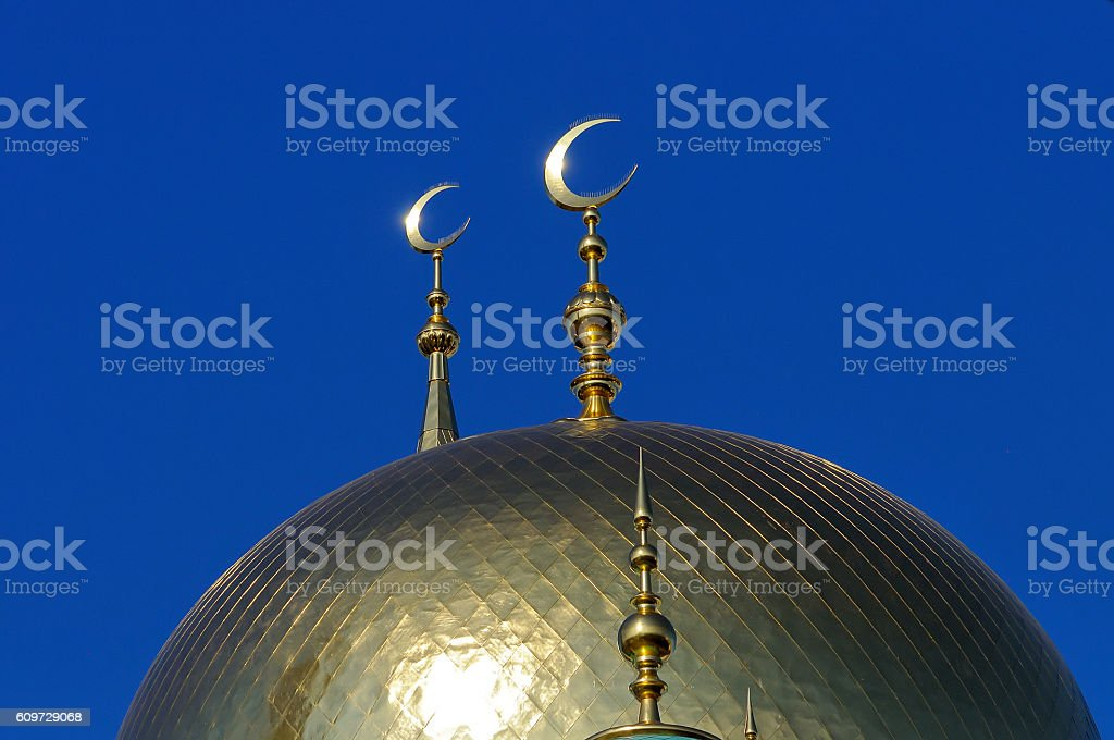 Gilded dome and crescent moon Muslim mosque stock photo
