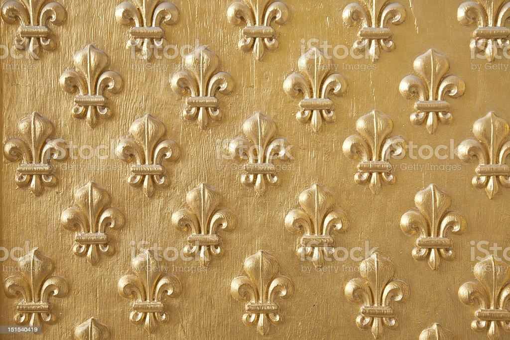 Gilded Fleur de Lys pattern stock photo