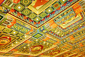 Gilded red patterns on the ceiling in interior